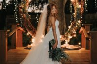 14 a round wedding arch decorated with dried greenery and herbs, twigs and lights for a chic look with a rustic feel