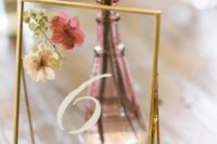 16 elegant gold frame table number with pressed blooms and herbs are amazing for a late summer or fall wedding
