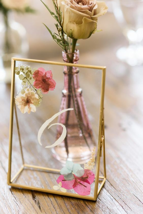 elegant gold frame table number with pressed blooms and herbs are amazing for a late summer or fall wedding