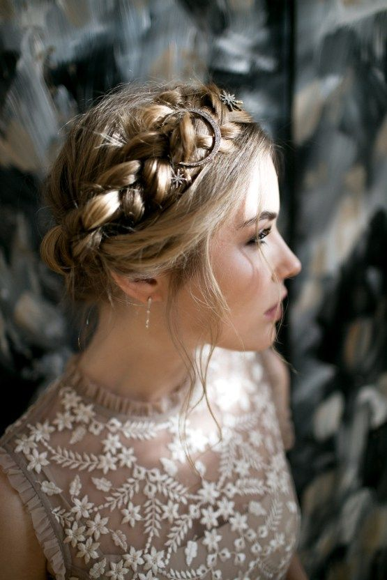 a halo braided updo with some star hair pins and a moon one for an ultimate boho look
