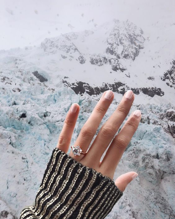 a unique diamond ring shaped as a snowflake for a winter proposal in the mountains - it will remind you of the location