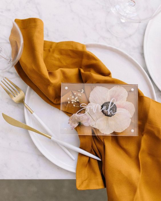 gorgeous place cards with tender pressed blooms and white calligraphy will make each place setting more unique