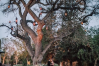 19 a beautiful idea of a summer or fall proposal with a romantic space, petals, candle lanterns and lanterns on the tree but just you two