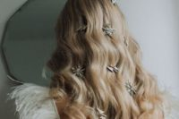 19 oversized star and thunderbolt rhinestone hair clips are amazing on messy long hair or on long waves like here