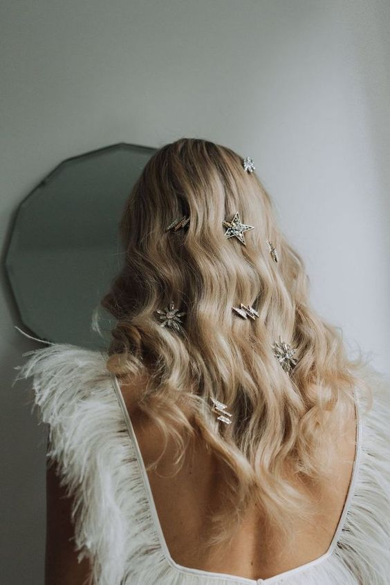oversized star and thunderbolt rhinestone hair clips are amazing on messy long hair or on long waves like here