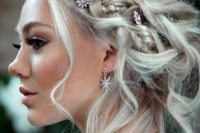 20 a braided messy updo accented with rhinestone star hair pins and matching earrings for a celestial bride