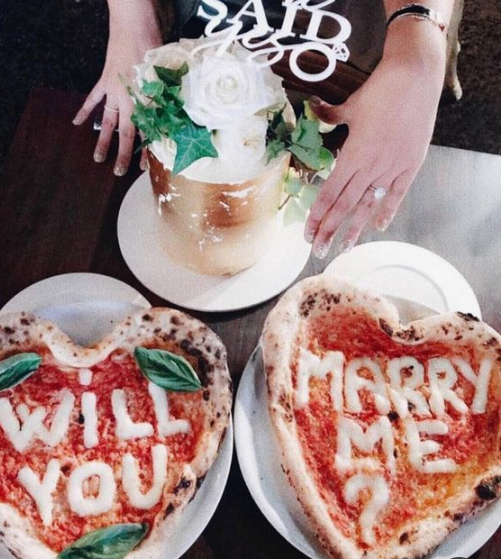 a creative and casual proposal on pizzas for a couple who doesn't like anything formal or too solemn
