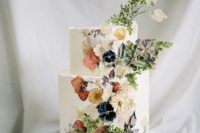 21 a decadent wedding cake with dried and pressed flowers plus foliage is a gorgeous idea for many wedding styles