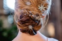 21 a messy and textural low bun accented with star and flower rhinestone hairpins for a chic modern look
