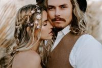 22 a messy boho hairstyle with waves down and a braid accented with multiple star hair pins for a boho celestial bride