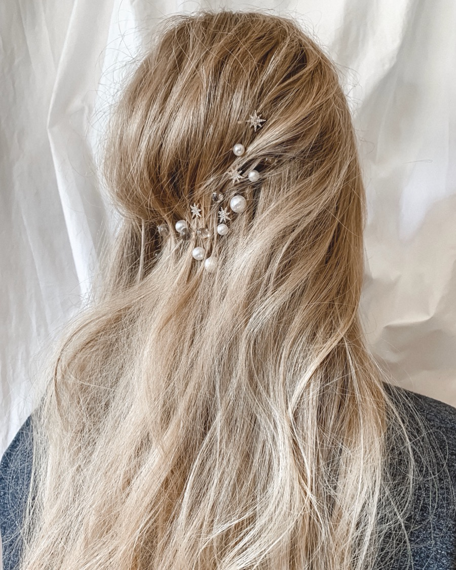 messy hair with a texture and some pearl, star and sheer hair pins are amazing for a celestial bride