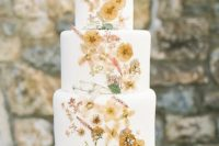 24 a swoon-worthy wedding cake with pressed blooms and greenery in neutral shades is a tender idea