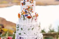 25 a textural white wedding cake was done with pressed flowers and greenery is a bold and fun idea for a summer wedding