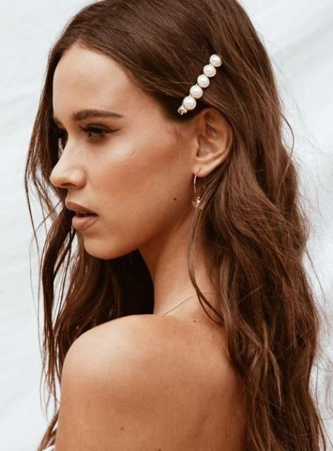 a refined modern wedding hair barrette with pearls will refresh your long waves making them look trendier