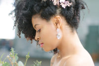 29 natural curls raised up and accented with gold flowers looks veyr refined, chic and bold