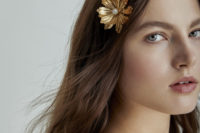 31 loose waves with gold flower hair pins that add a refined and chic touch to the simple hairstyle