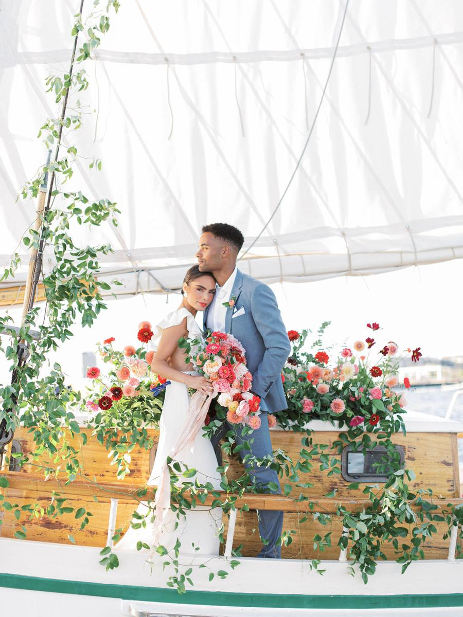 This bright elopement took place on board a ship in Boston Harbor