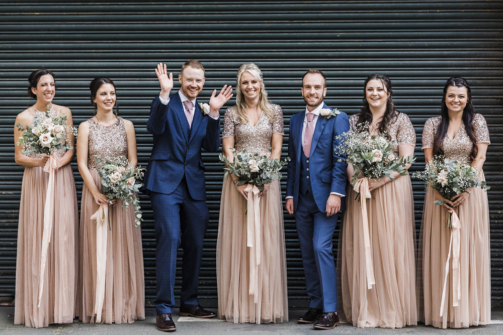 This industrial same sex wedding was done with a relaxed vibe and with blush and blue attire
