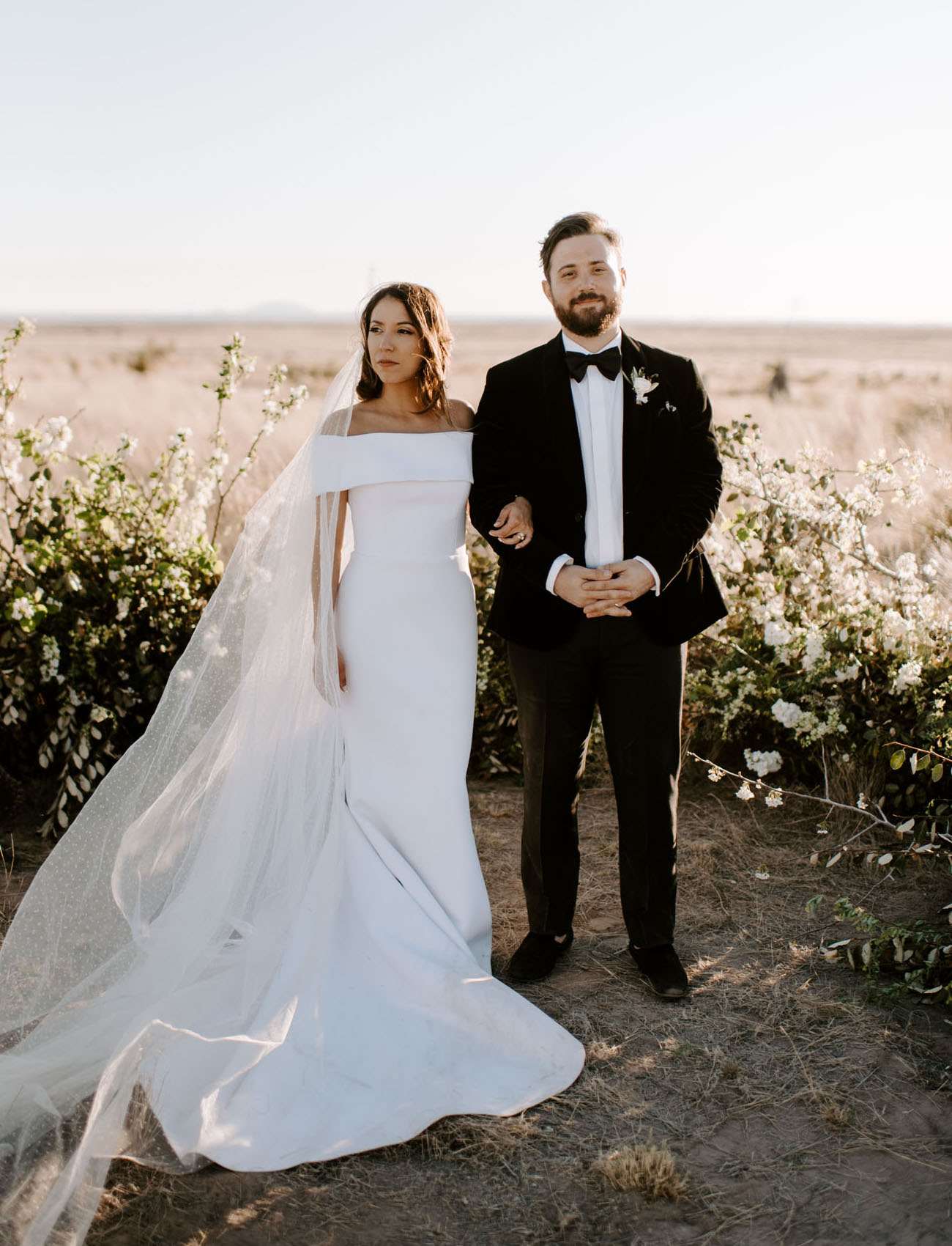 This modern black and white wedding took place in the desert and was done with perfect modern elegance
