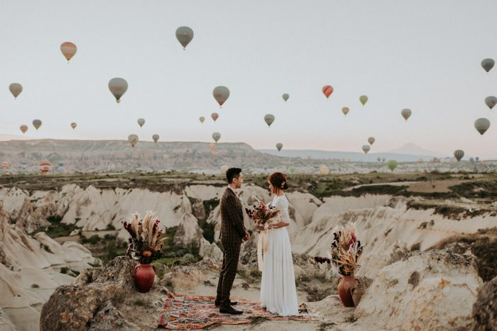 This unique elopement took place in Cappadocia, Turkey, with over 100 hot air balloons in the air