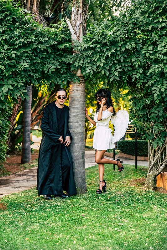 The bride dressed as a little angel with Steve Madden shoes and the groom dressed as Neo from the Matrix