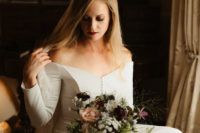 02 The bride was wearing a plain off the shoulder wedding dress with long sleeves and a button row plus a lace veil
