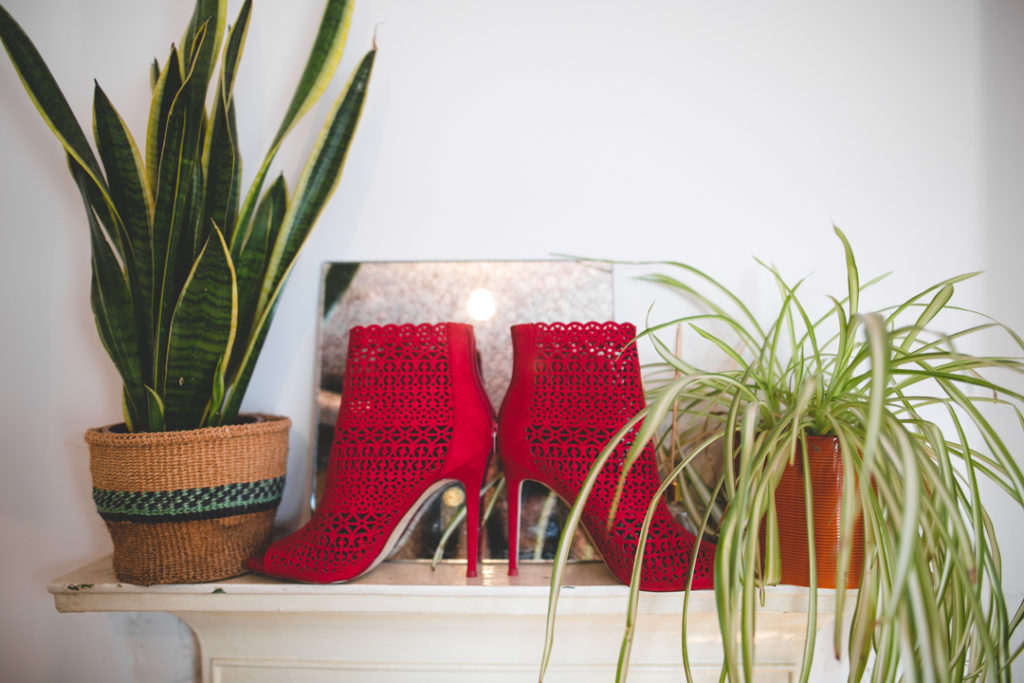 an awesome red laser cut shoes for a birde