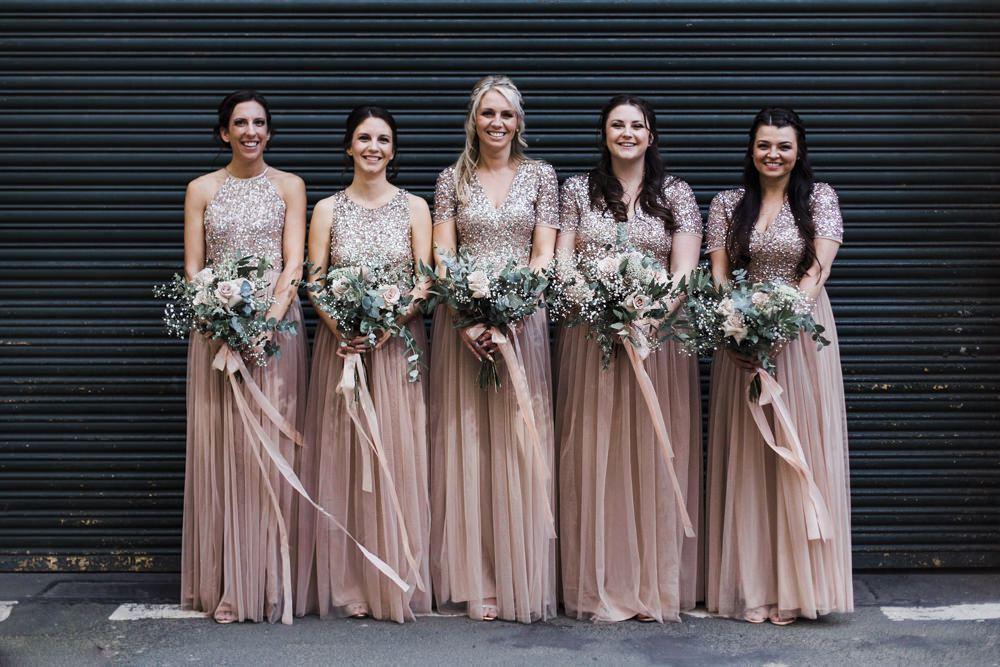 The bridesmaids were wearing gorgeous blush maxi dresses with sequin bodices and pleated skirts