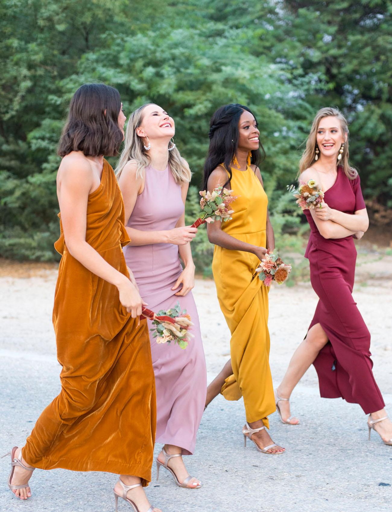The bridesmaids were wearing maxi bridesmaid dresses in various bright shades