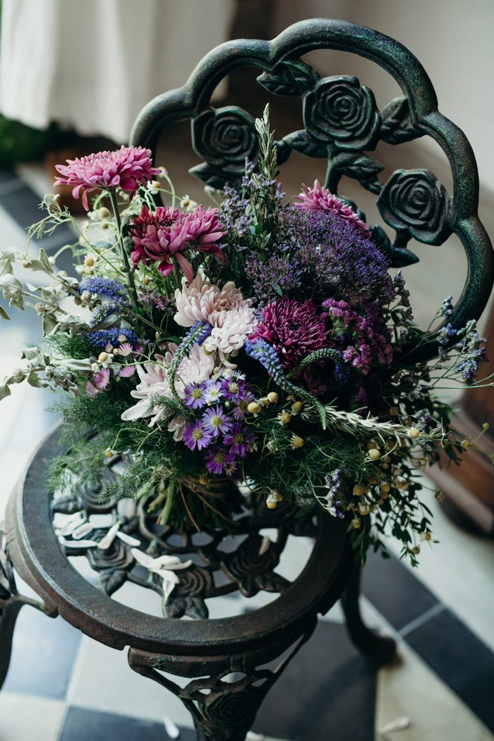 The wedding bouquet was done in purple, pink and blush, with textural greenery included