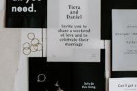 a wedding invitation suite in black and white color scheme