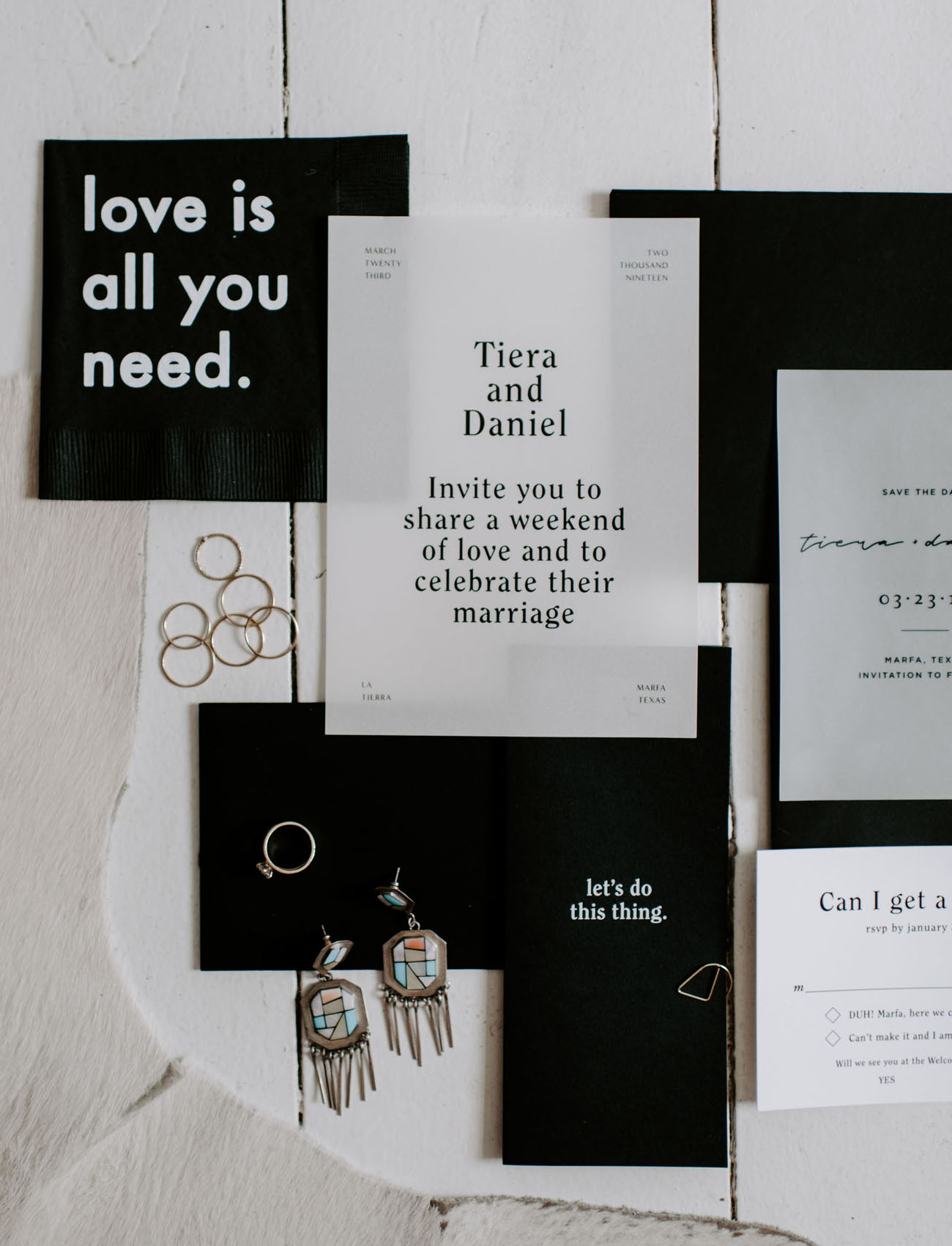 a wedding invitation suite in black and white color scheme