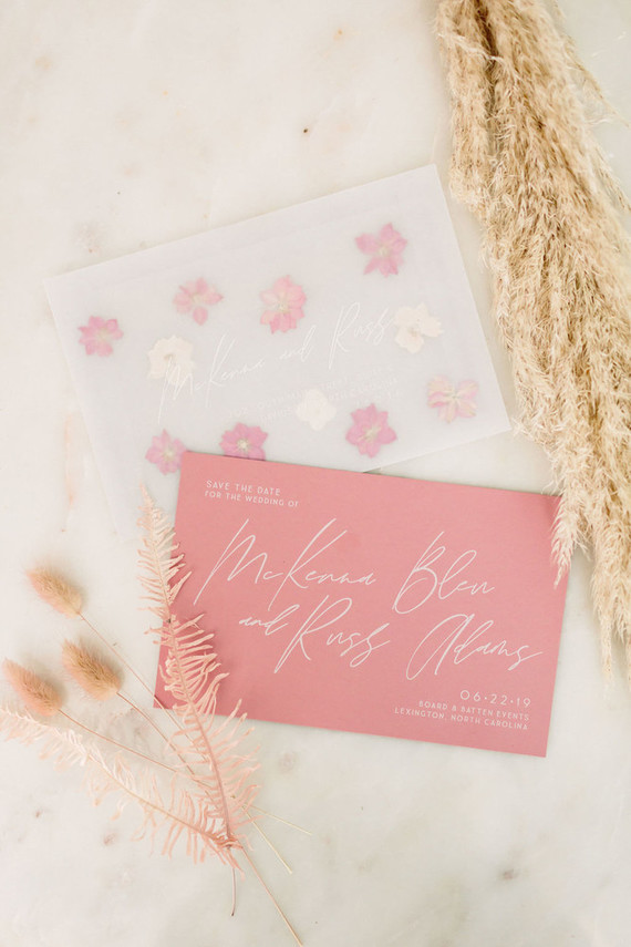 The wedding stationery was done in neutral and pink, with dried blooms and calligraphy