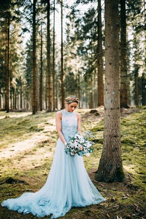 a beautiful blue A-line wedding dress with a lace bodice, no sleeves and a layered skirt with a train