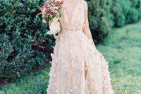 02 a blush A-line wedding dress with floral appliques and plunging neckline plus a front slit for a romantic bride