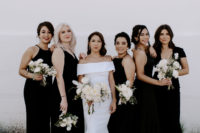 03 The bride was wearing an off the shoulder sheath wedding dress, the bridesmaids were rocking mismatching black gowns