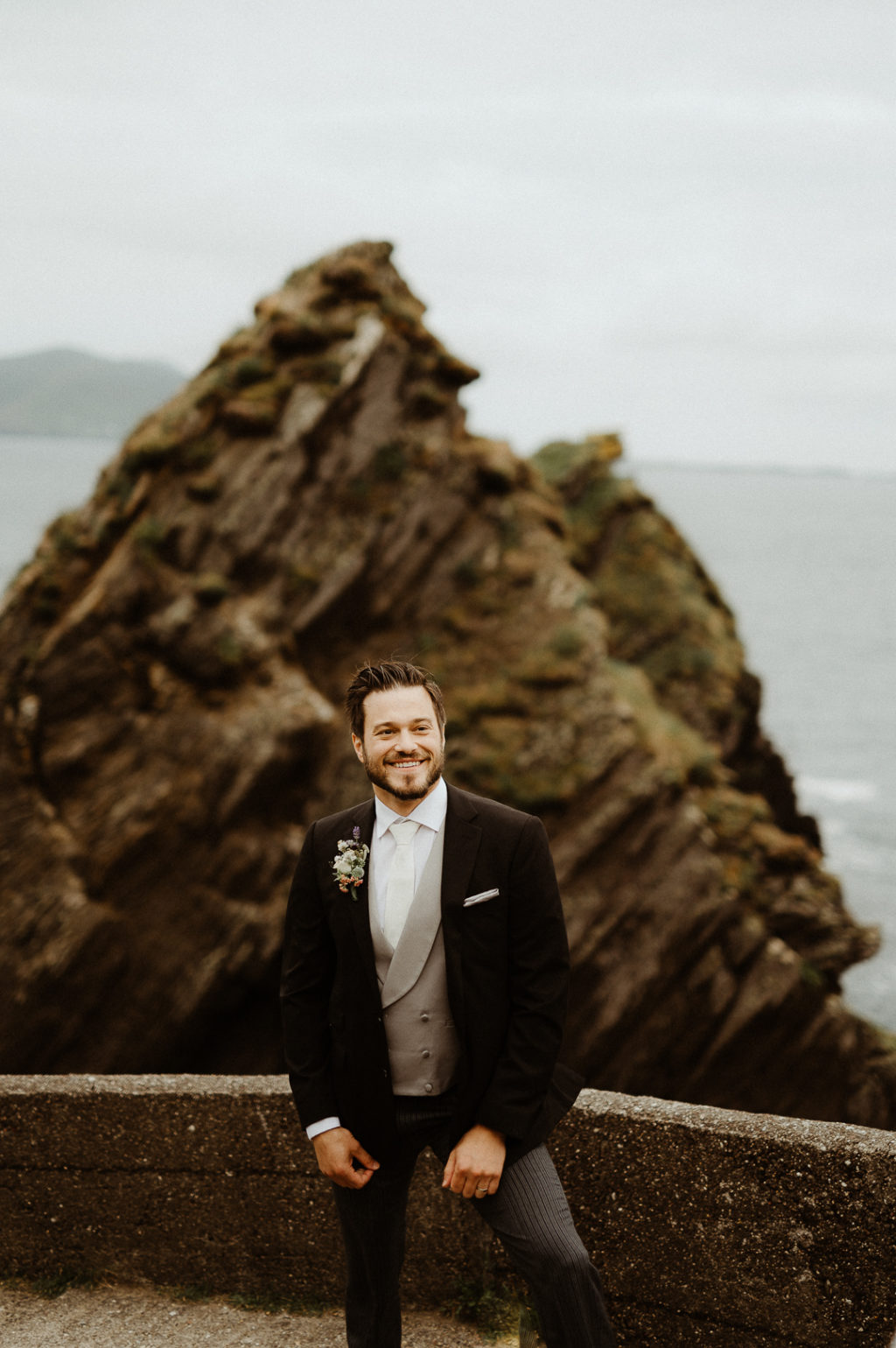 a groom's look with an awesome floral boutonniere