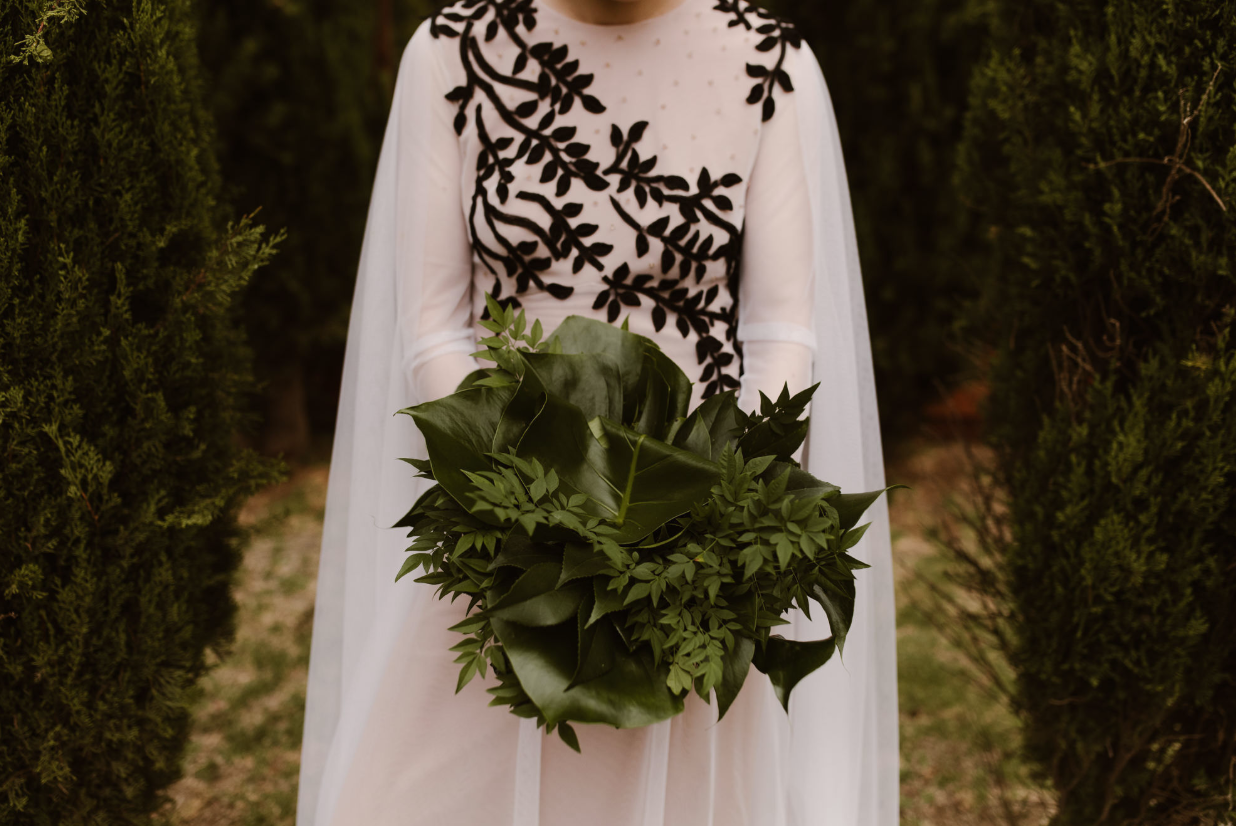 The wedding bouquet was done with monstera leaves and greenery