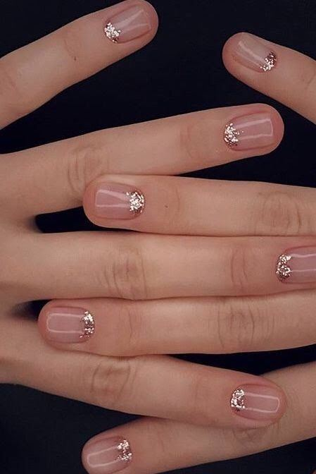 shiny blush nails with rose gold glitter is a gorgeous idea for a glam or NYE wedding