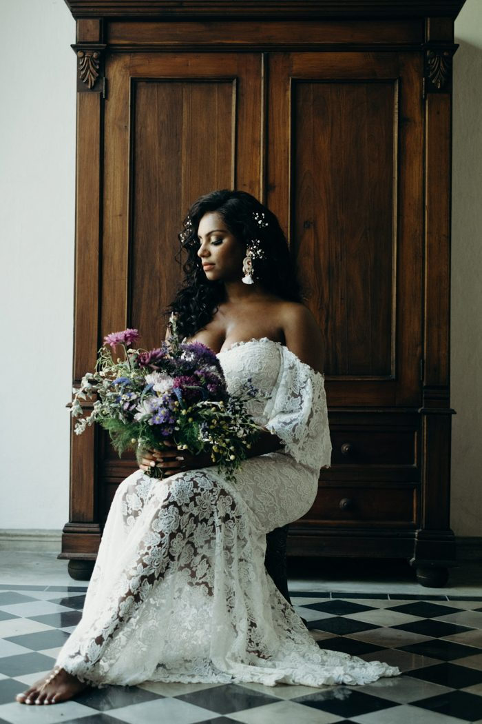 Asia chose a beautiful off the shoulder lace wedding dress and statement boho earrings