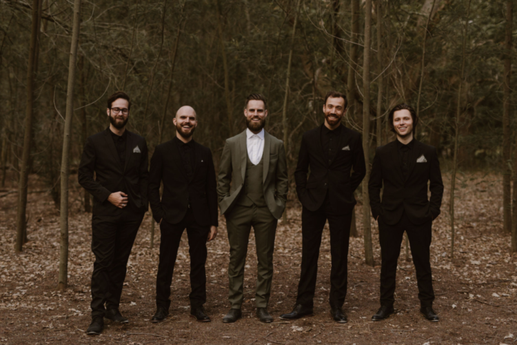 The groom was wearing an olive green three-piece suit, and the the groomsmen were rocking all black