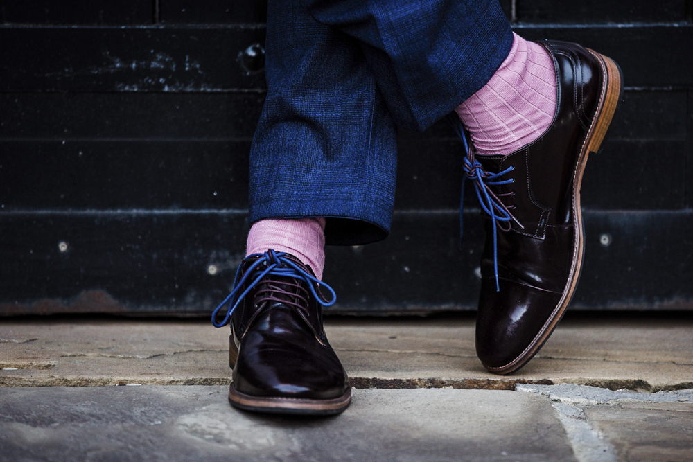 The groom's style was quirky and fun   with bright blue laces and pink socks