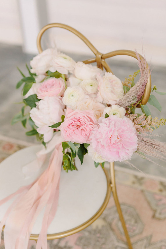The wedding bouquet was done with light pink and blush blooms and dried herbs