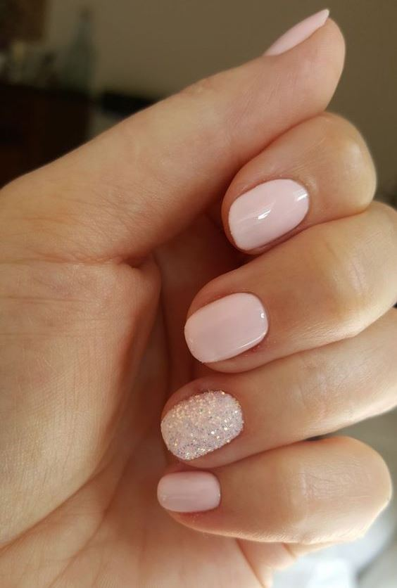 a blush wedding manicure and a white glitter accent nail for a winter or just glam bride