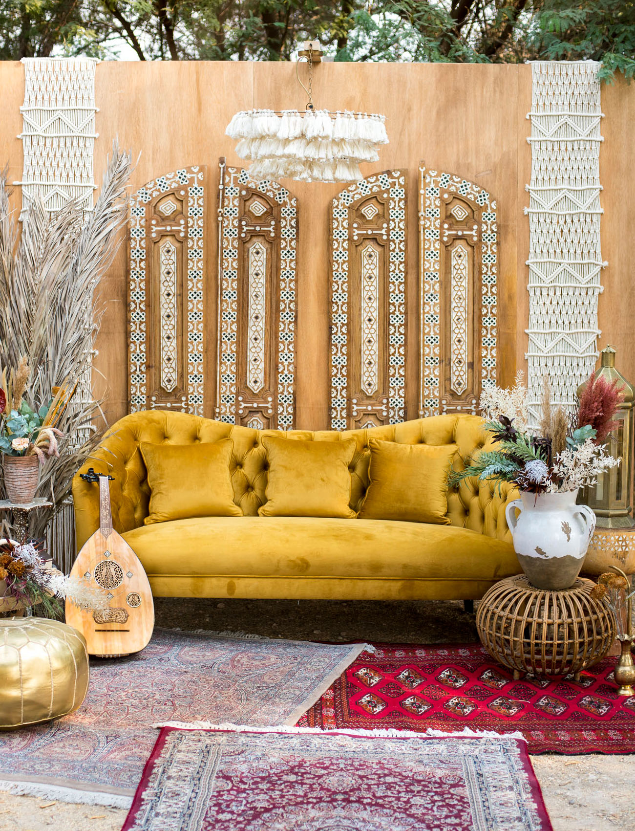 The lounge was truly boho, in burgundy and mustard shades, boho rugs and macrame and tassels