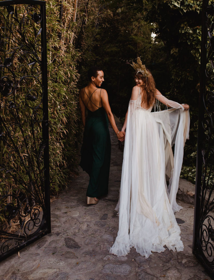 The second bride was rocking a forest spaghetti strap wedding dress and silver wedges