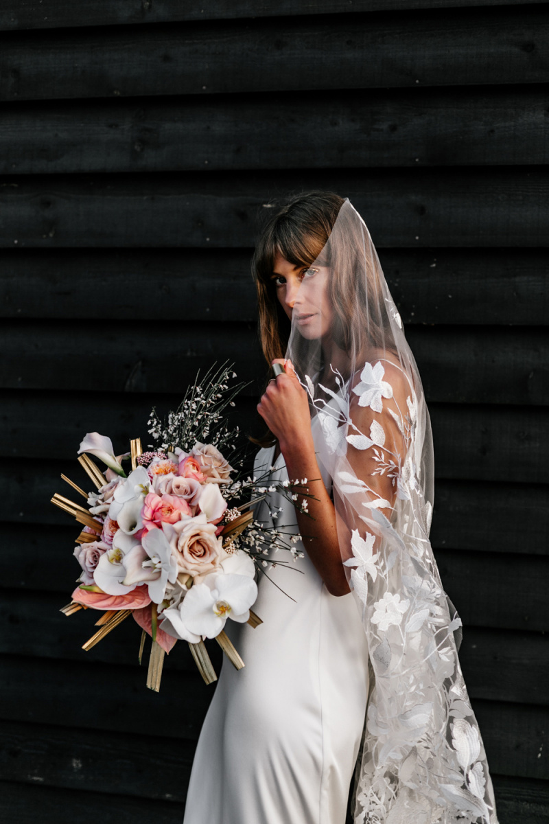 The wedding bouquet was done with pink and white blooms and dried fronds