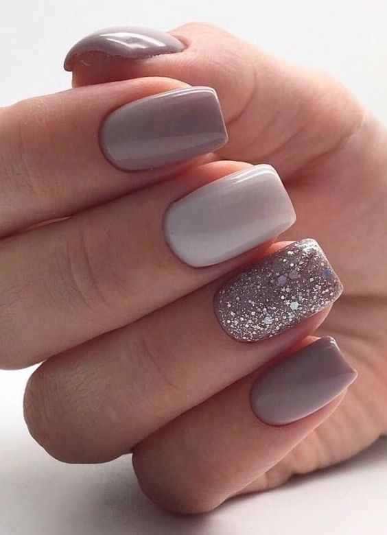 a grey and white wedding manicure and a shiny glitter accent nail for a stylish neutral look
