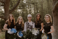 06 The bridesmaids were rocking black illusion neckline tops and cropped pants plus monstera leaf bouquets