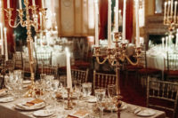 06 The wedding tablescape was done with metallic candelabras, neutral menus and candles for a refined touch